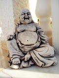菩萨笑的雕象 库存照片