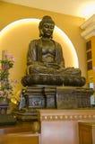 菩萨雕塑侧视图 库存图片