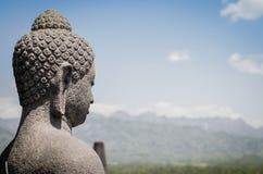 菩萨雕象俯视山 库存照片