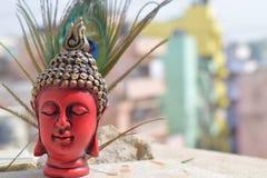菩萨雕象在五颜六色的背景中 库存图片