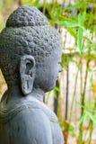 菩萨雕象在禅宗庭院里 免版税库存图片