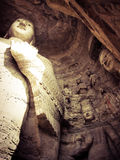 菩萨雕象在洞雕刻的中国 图库摄影