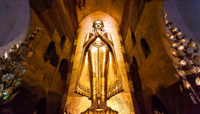 菩萨雕象在Bagan的,缅甸塔 免版税图库摄影