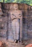 菩萨雕象被雕刻对岩石 图库摄影