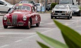 菲亚特1100 S berlinetta Gobbone 1948年和蓝旗亚 库存照片