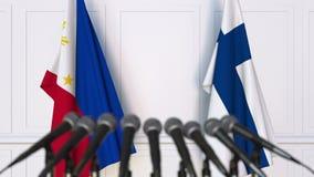 菲律宾和芬兰的旗子在国际会议或交涉新闻招待会 3D动画 股票视频