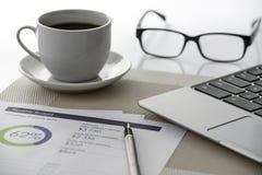 经营分析和咖啡 库存照片