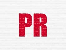 营销概念:在墙壁背景的PR 免版税库存照片