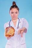 营养师用小甜面包小圆面包 不健康的速食 免版税库存照片