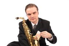 萨克斯管吹奏者 免版税库存图片
