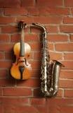 萨克斯管小提琴 免版税库存照片