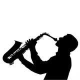 萨克管演奏员剪影画象 免版税库存照片