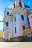 萨尔茨堡,奥地利- 2017年5月01日:巴洛克式的牧师会主持的教堂在萨尔茨堡是大学教会 免版税库存照片