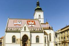 萨格勒布,克罗地亚- 2013年:圣马克的教会是老萨格勒布教区教堂,位于圣马克的广场 它在被修造了 图库摄影