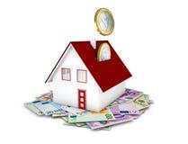 落在房子概念的欧洲硬币 图库摄影
