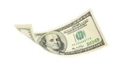 落在白色背景的一百元钞票 免版税库存图片