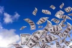 落的货币天空 免版税库存图片