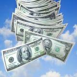 落的货币天空 免版税库存照片