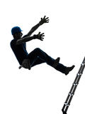落从梯子剪影的体力工人人 免版税库存照片