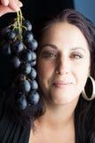 葡萄妇女 免版税库存照片