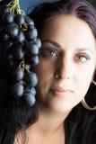 葡萄妇女 免版税图库摄影