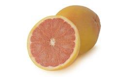 葡萄柚和一半在白色背景 免版税库存照片