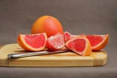 葡萄柚和切片 图库摄影