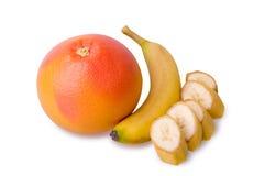 葡萄柚和切的香蕉 库存图片