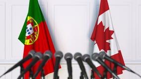 葡萄牙和加拿大的旗子在国际会议或交涉新闻招待会 影视素材