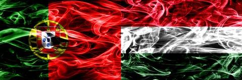 葡萄牙对匈牙利,肩并肩被安置的匈牙利烟旗子 葡萄牙语和匈牙利,Hungari的厚实的色的柔滑的烟旗子 皇族释放例证