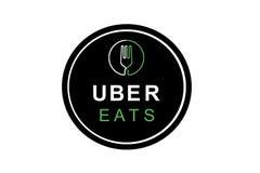 葡萄牙,里斯本, 2018年6月16日:UBER的例证吃商标 食物交付的一家普遍的企业在家和 库存照片