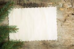 葡萄酒与圣诞树的白纸卡片分支 免版税库存照片
