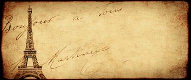 葡萄酒与老纸纹理和埃菲尔Towe的难看的东西背景 免版税库存照片