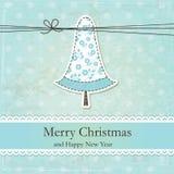 葡萄酒与逗人喜爱的圣诞树的圣诞节背景 库存图片