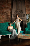 葡萄酒内部的两名迷人的妇女 库存图片