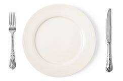 葡萄酒刀子、叉子和板材在白色背景 免版税库存照片