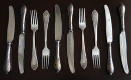 葡萄酒刀子和叉子在黑暗的背景 图库摄影