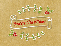 葡萄酒圣诞快乐在乱画样式的丝带横幅在工艺p 免版税库存照片