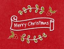 葡萄酒圣诞快乐在乱画样式的丝带横幅在工艺p 库存照片