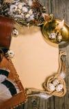 葡萄酒垂直嘲笑在土气木委员会 烛台、鸡蛋在一点篮子里面,绳索笔记本、片断和纸片 免版税图库摄影