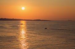 葡萄酒定了调子海日落的图片 免版税库存照片