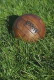 葡萄酒布朗橄榄球足球绿草领域 免版税库存图片