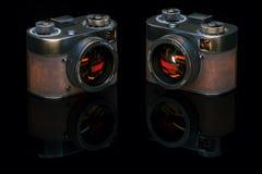 葡萄酒影片照片照相机在黑演播室 3d回报 免版税图库摄影