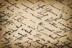 葡萄酒手写 古色古香的剧本 背景接近的纸射击 免版税库存照片