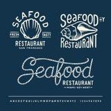 葡萄酒有字母表的海鲜餐馆 免版税库存照片