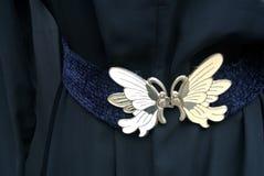 葡萄酒有蝴蝶型金属扣的织品传送带 库存图片