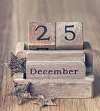 葡萄酒木日历在25设置了12月 库存图片