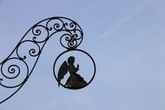 葡萄酒标志,下跪天使 免版税图库摄影