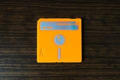 葡萄酒橙色磁盘背景 库存照片