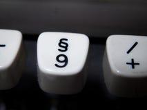 葡萄酒段和第九钥匙在打字机 库存照片